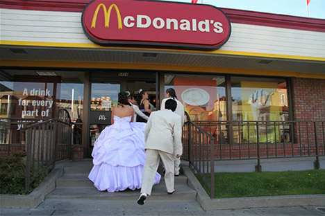 Group dressed in formal wear walking into a MacDonald's