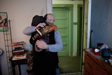 Two people hugging in a room