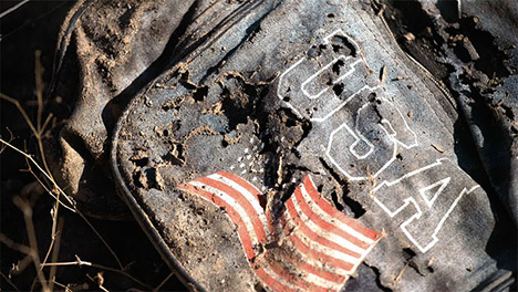 Muddied backpack with USA flag