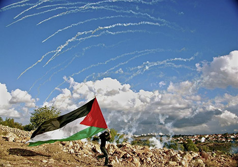 person running with a Palestinian flag
