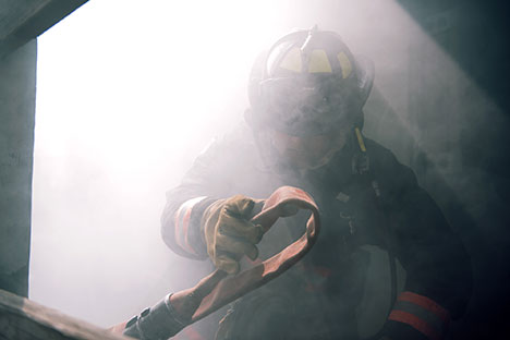 Firefighter shrouded in smoke