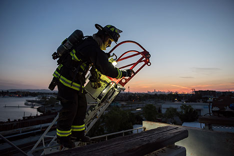 Firefighter at top of ladder
