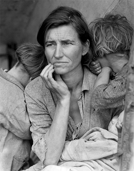 Dorothea Lange photo of tired looking woman with children on either side of her