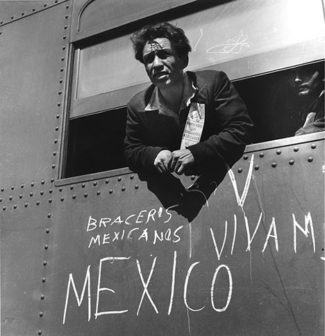 Dorothea Lange photo shows a man looking out from a train window